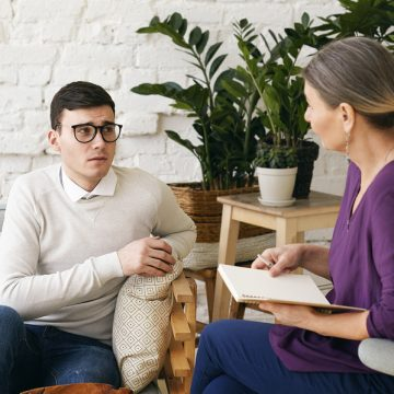 Senior Woman Psychotherapist Or Counselor Writing Something Down